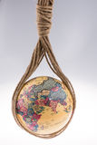 Globe hanging in rope Stock Photography