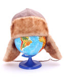 Globe with hat. On it Royalty Free Stock Images