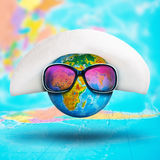 Globe with hat and pink sunglasses Stock Images