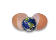 The globe hatching from egg. Isolated object on a white background. Source from globe: http://visibleearth.nasa.gov Royalty Free Stock Photo