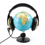 Globe and headphone Royalty Free Stock Image