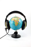 Globe and headphone Royalty Free Stock Images