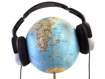 Globe with headphones Stock Photo