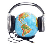 Globe with headphones. On it Royalty Free Stock Photo