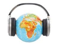 Globe with headphones. On it Stock Photo