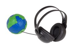 Globe and headphones Royalty Free Stock Photos