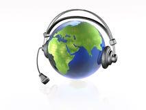 Globe with headphones Royalty Free Stock Image