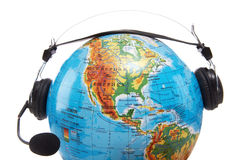 Globe with headset Royalty Free Stock Images