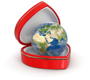 Globe in the heart box (clipping path included) Royalty Free Stock Images