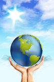 Globe held by hands Royalty Free Stock Image