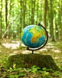 The globe on hemp in summer wood. Stock Photos