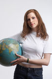 The globe in her hands Stock Image
