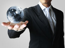 Globe in his hand Royalty Free Stock Photo