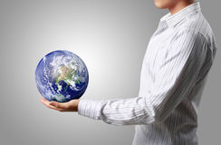 Globe in his hands,Earth image provided by NASA. Royalty Free Stock Photo