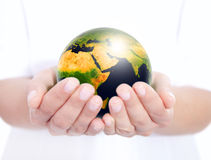 Globe holded in human hands Royalty Free Stock Images