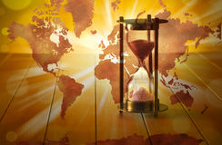 Global Hourglass Time Climate Change. A conceptual image with an hourglass with a world map Stock Photos