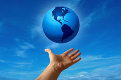 Globe in Human Hand royalty free stock image