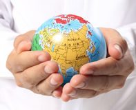 Globe  in human hand Royalty Free Stock Photography
