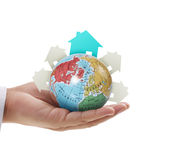 Globe in human hand Stock Images