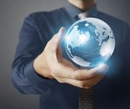 Globe ,in human hand, hand holding our planet earth glowing. Ear Stock Images