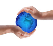 Globe in human hands Stock Photo