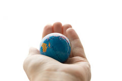 Globe in human palm Royalty Free Stock Photos