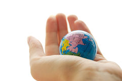 Globe in human palm Royalty Free Stock Images