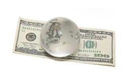 Globe on hundred dollar Stock Photography