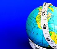 Globe. Image of a globe and a tape measure representing a weight loss on a global scale royalty free stock photo