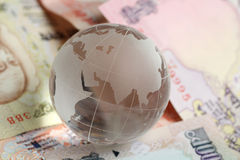 Globe on indian currency royalty free stock images