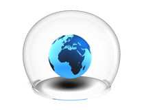 Globe inside glass bowl Stock Images