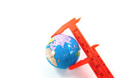Globe inside vernier calipers Royalty Free Stock Images