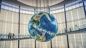 Globe with interactive projections inside National Museum of Emerging Science and Innovation, Miraikan, Tokyo, Japan royalty free stock photography