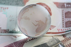 Globe on iranian currency royalty free stock image