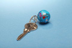 Globe and key chain Stock Images