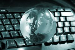 Globe and keyboard stock photo