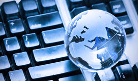 Globe on keyboard. Glass globe on keyboard background Royalty Free Stock Photo
