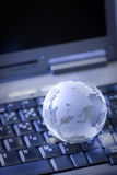 Globe on keyboard Royalty Free Stock Photo