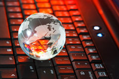 Globe on keyboard Stock Images
