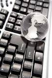 Globe on keyboard Royalty Free Stock Photography