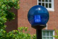 Globe léger bleu de sphère de police Photo libre de droits