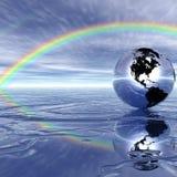 Globe, l'eau, arc-en-ciel. Image libre de droits