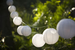 Globe lanterns. Paper Globe japanese lanterns hanging on a string at a party stock photography