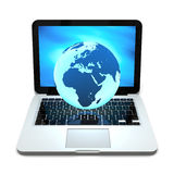 Globe on laptop Royalty Free Stock Image