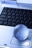 Globe and laptop Stock Photos