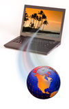 Globe and laptop computer Stock Image