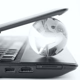 Globe on a laptop keyboard Stock Photos