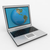 Globe into laptop screen Stock Photo