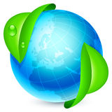 Globe and leaves. Blue globe under fresh green leaves Stock Photography