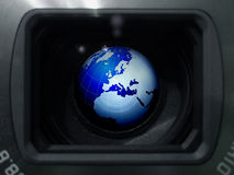 Globe in the lens Royalty Free Stock Image